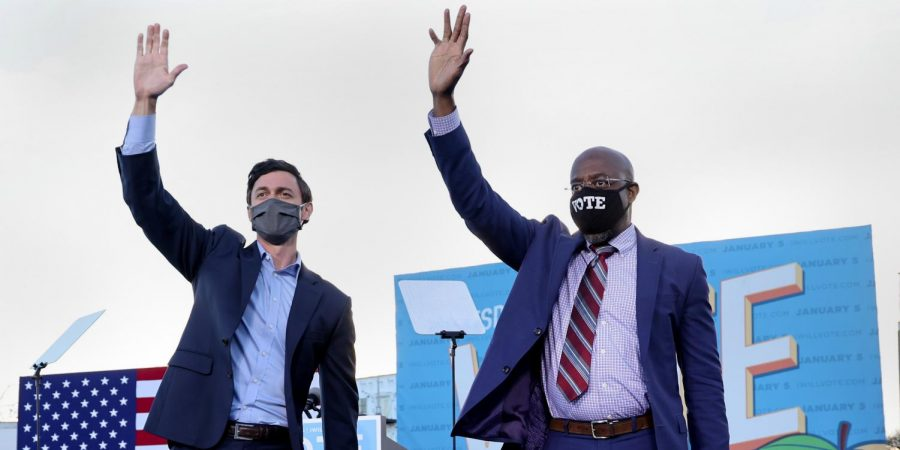 Senators-elect Jon Ossoff and Reverend Raphael Warnock campaign together at a rally in Atlanta on Jan. 4. Reverend Warnock will go on to be the first black senator to ever represent a former confederate state, and both flip the Senate Majority to the Democrats.