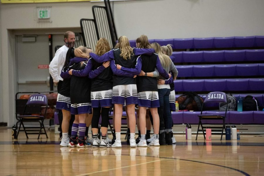 Pictured+above+the+girls+basketball+team+huddles+up+before+their+game+on+March+3rd.