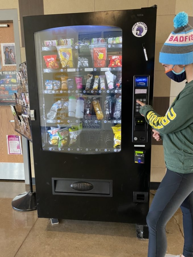 SHS student uses the vending machine.