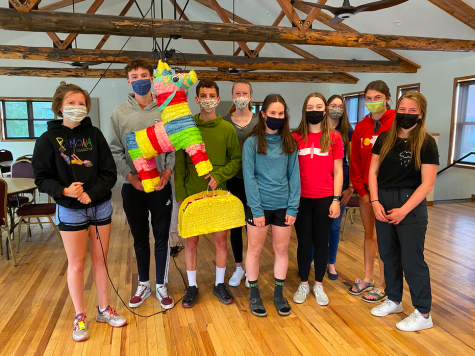Students from the ESL program headed by junior Elijah Wilcox stand smiling at their final meeting on Friday, May 21, complete with pinatas for their fiesta. From left to right are juniors Kate Adams, Arlo Follet, Elijah Wilcox, senior Hannah Rhude, junior Gwen Ramsey, senior Cassidy Gillis, 8th grader Kyndra Johnson, and sophomores Lane Baker and Amy Adams.